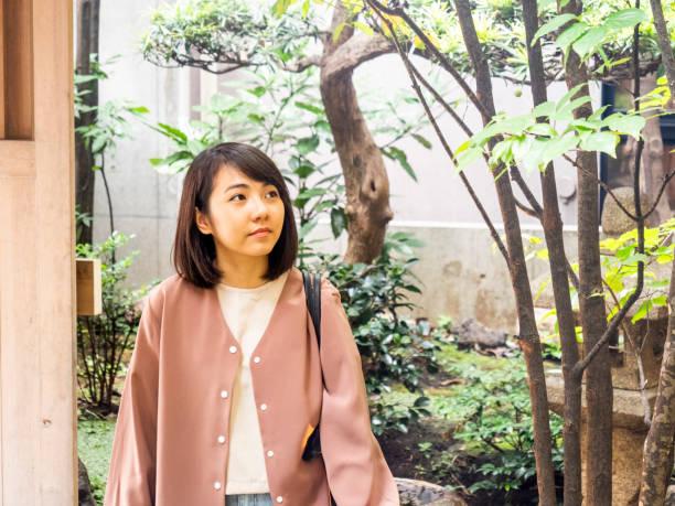 Thai woman visiting small garden in Tokyo. stock photo