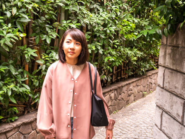 Thai woman walking small street in old town Tokyo. stock photo