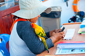 Bangkok, Thailand, March 05, 2015; Thai women working with parrot