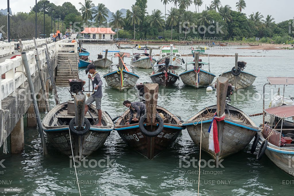 Thai workers work at Ao Nammao pier royalty-free stock photo