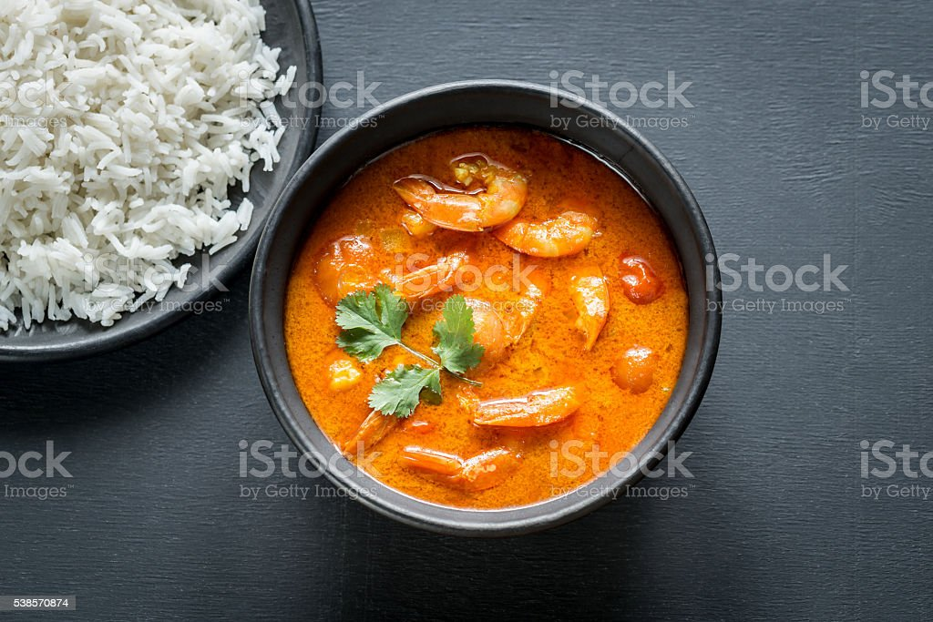 Thai yellow curry with seafood and white rice stock photo