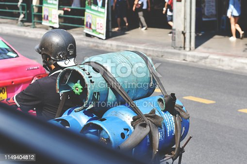 Thailand 1 May 2019 : Liquefied petroleum gas delivered by motorcycle in Bangkok, Thailand