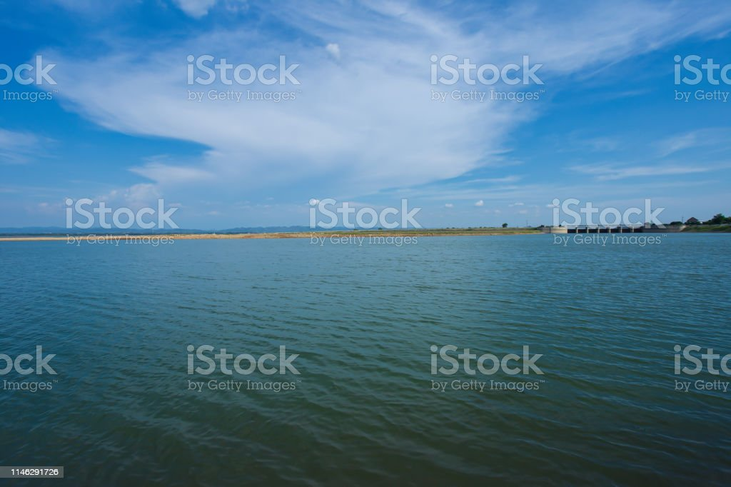 A dried up empty reservoir or dam during a summer heatwave, low...