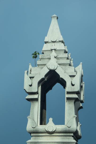 Thailand Bridge pillar with Little Tree grow up on it in Travel Concept stock photo