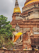 Buddhist statue in front of ancient Thai temple Ayutthaya