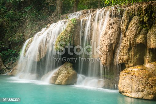 This is a horizontal color photograph of the lush landscape of Southeast Asia travel destination, Erawan Falls National Park in the Kanchanaburi province of Thailand. There are no people.