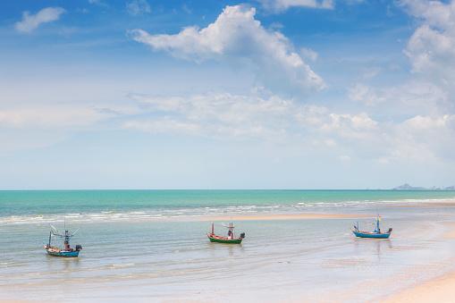Thailand fishing boat waiting on the beach at HuaHin, Thailand