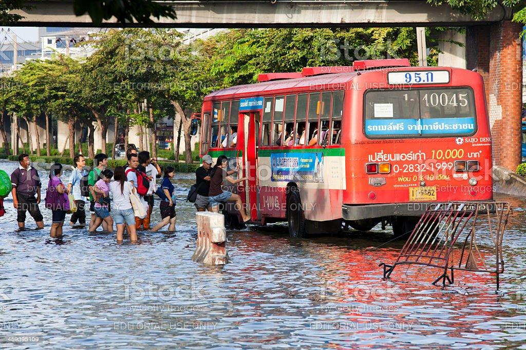 Thailand floods - People getting on bus royalty-free stock photo