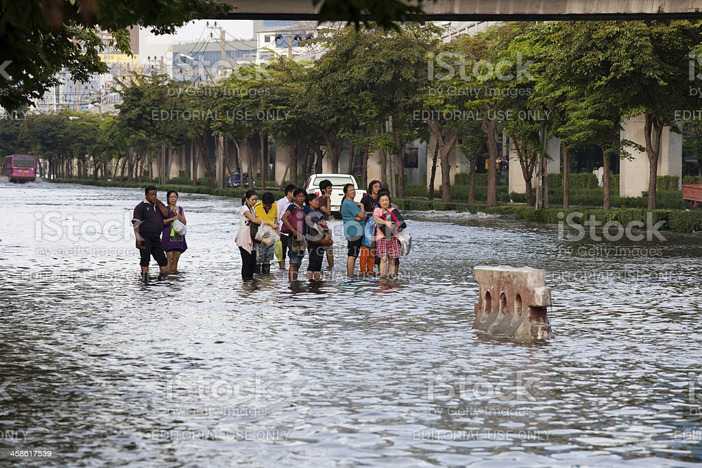 Thailand floods - People waiting for transportation royalty-free stock photo