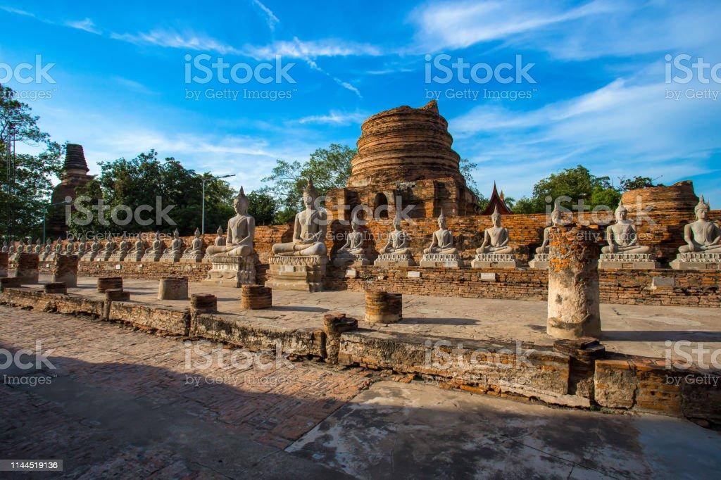 Ancient buddha statues and ruined pagoda at Wat Yai Chai Mongkol in...