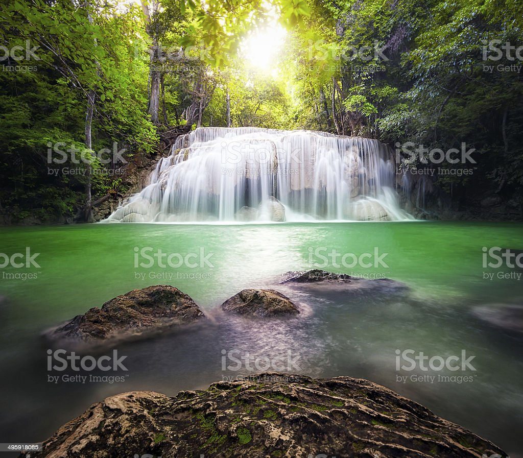 Thailand outdoor photography of waterfall in rain jungle forest. stock photo
