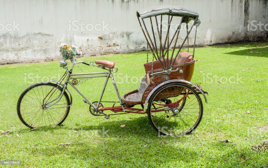 Thailand rickshaw three - wheeler Tricycle bicycle taxi for local people and tourists. old classic traditional asian tricycle stock photo