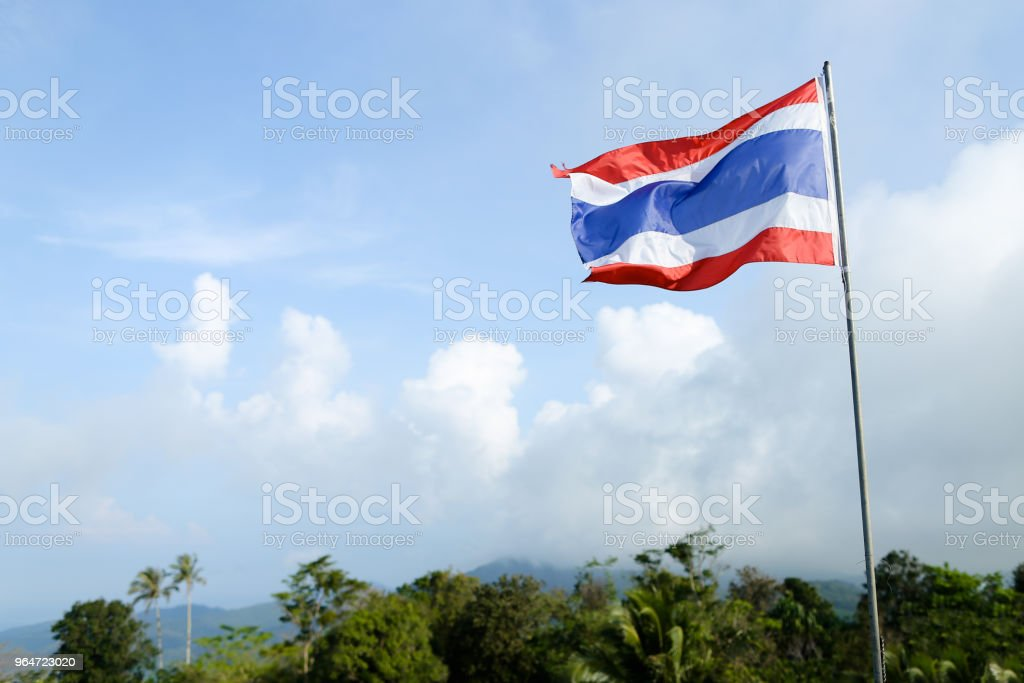 Thailand striped flag on blue sky background royalty-free stock photo