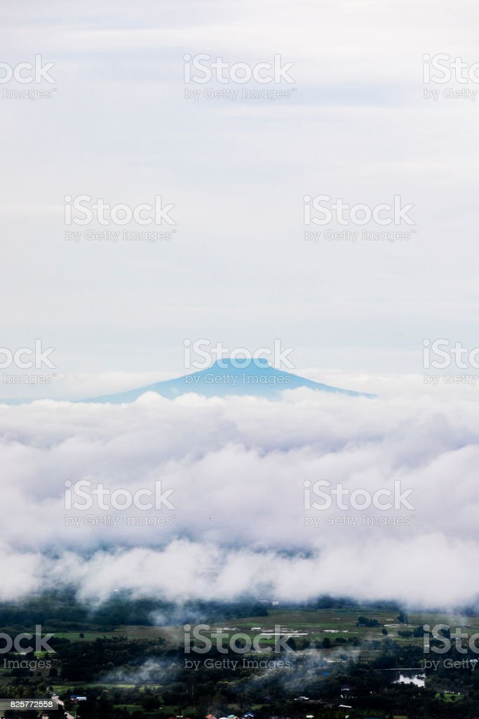 Thailand's Fuji alike mountain with with sea of fogs stock photo