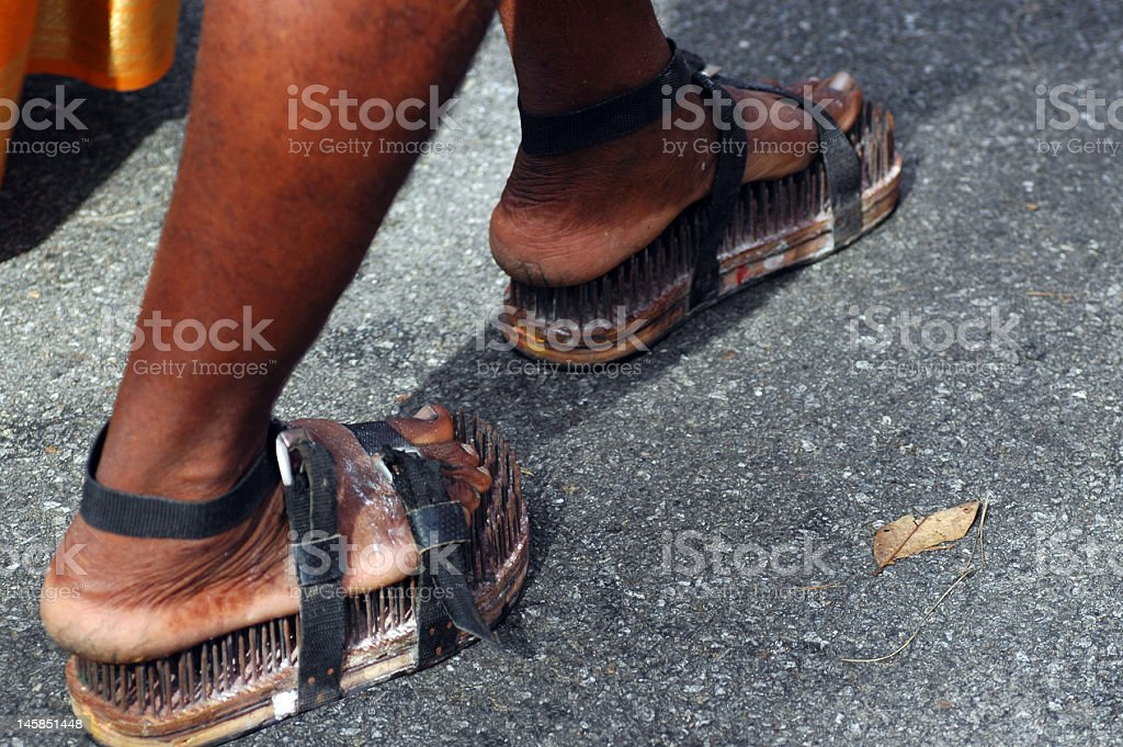Thaipusam Devotee Walking on Nails royalty-free stock photo
