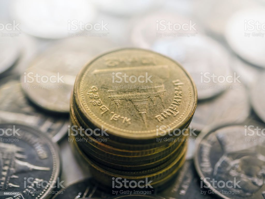 Thai's coins money on blurred background. Selective focus . stock photo