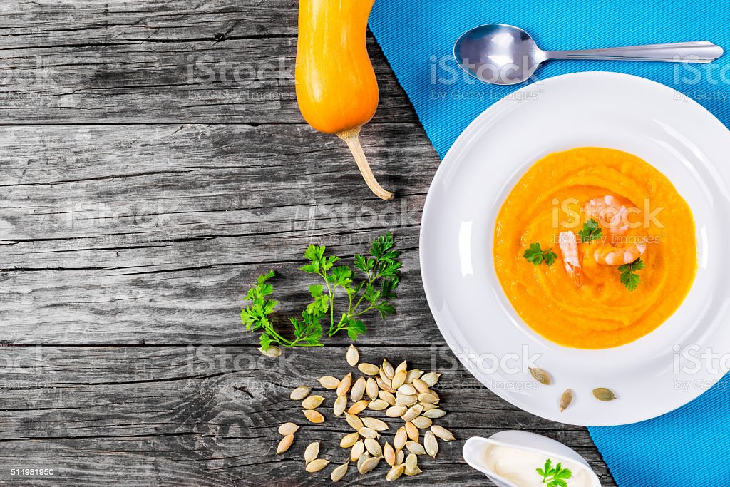 Thai-style Red Curry Pumpkin Soup With Prawns, view from above stock photo