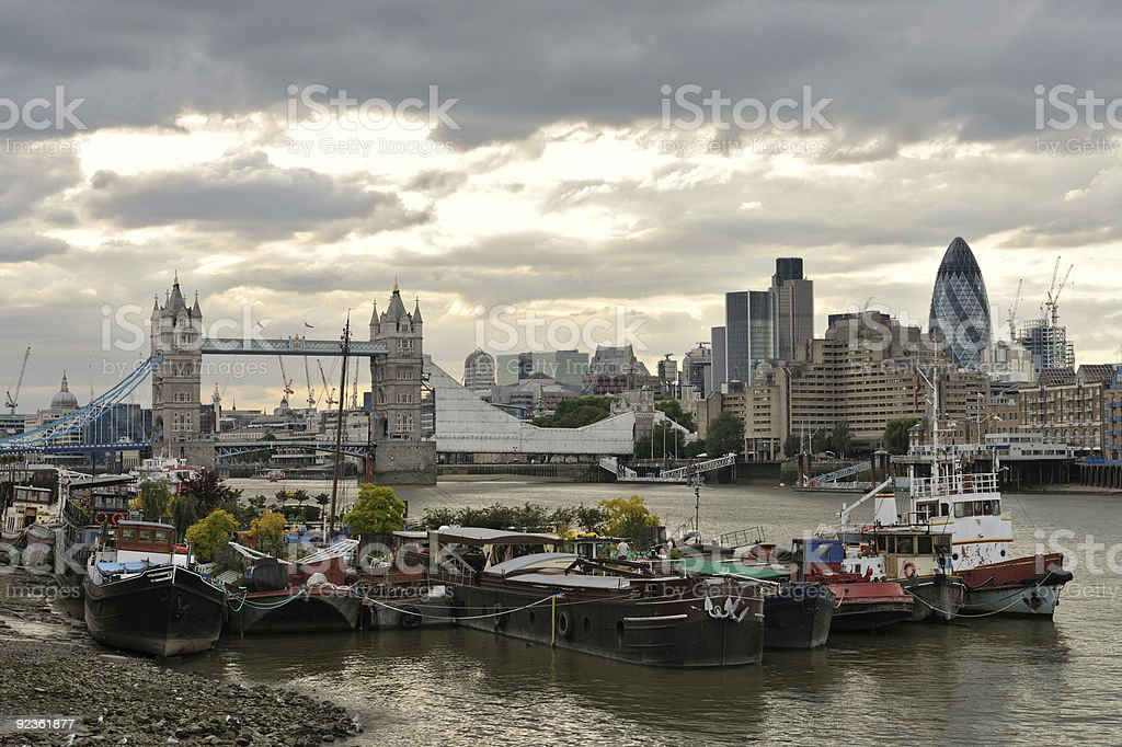 Thames houseboats, by Tower Bridge, London, England, UK stock photo