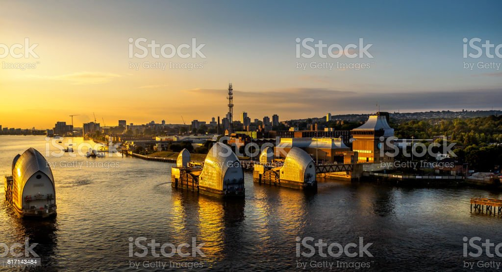 Thames tidal barrier at sunrise stock photo