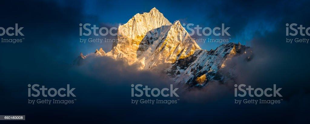 Thamserku 6623m Himalaya mountain peak panorama illuminated at sunset Nepal stock photo