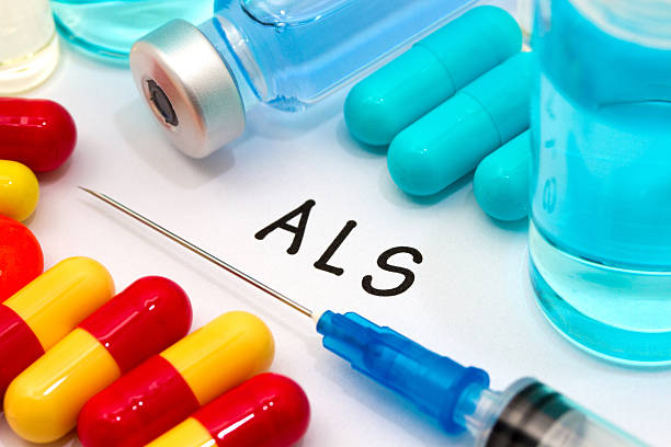 ALS ALS - diagnosis written on a white piece of paper. Syringe and vaccine with drugs. amyotrophic lateral sclerosis stock pictures, royalty-free photos & images