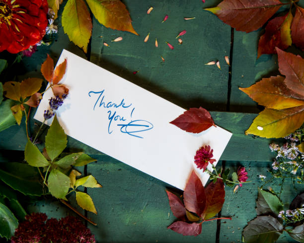 Thank you card and handwritten thank you note background with beautiful autumn colors stock photo