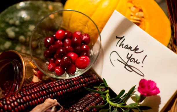 Thank you card in Thanksgiving Basket with  autumn harvest stock photo