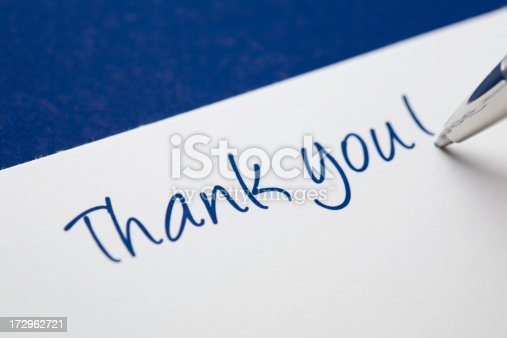 1050881964 istock photo Thank you card on blue 172962721