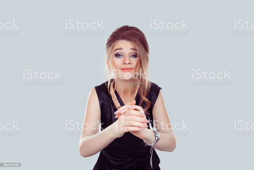 Thank you. Closeup portrait young woman gesturing with clasped hands, pretty please with sugar on top isolated light blue background. Human emotion facial expression feeling signs symbol body language stock photo