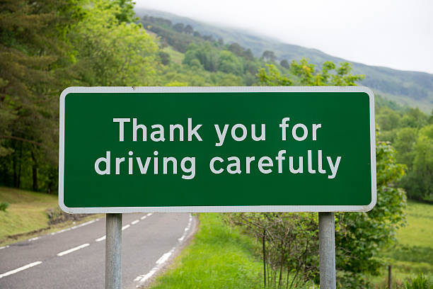 thank you for driving carefully sign - road signs stock photos and pictures