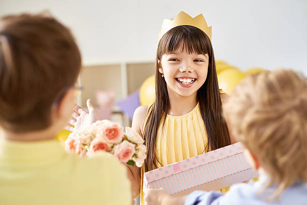 Thank you for gifts Happy girl receiving birthday presents group of friends giving gifts to the birthday girl stock pictures, royalty-free photos & images