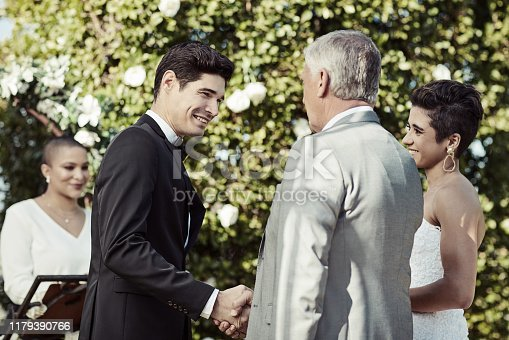 Shot of a mature man shaking his daughter's soon to be husband's hand on their wedding day