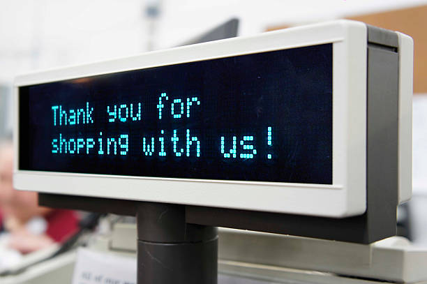 Thank you for shopping Thank you for shopping with us sign on cash register display. cash register stock pictures, royalty-free photos & images
