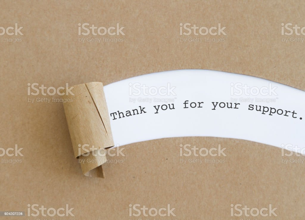 Thank you for your support written under torn paper.