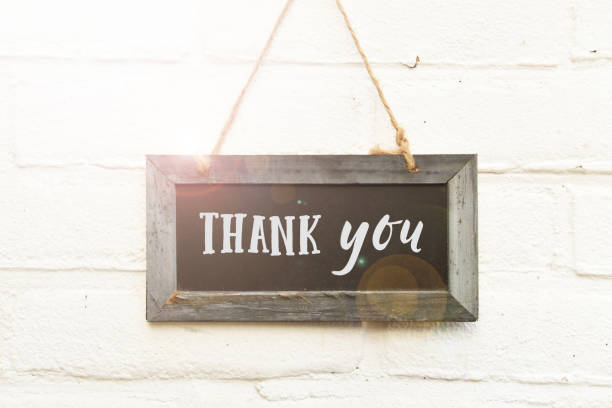 Thank you handwritten text on sign board card stock photo