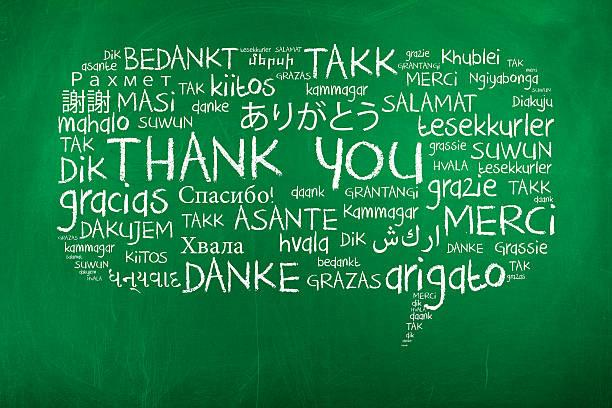 danke in verschiedenen sprachen - spanisch translator stock-fotos und bilder