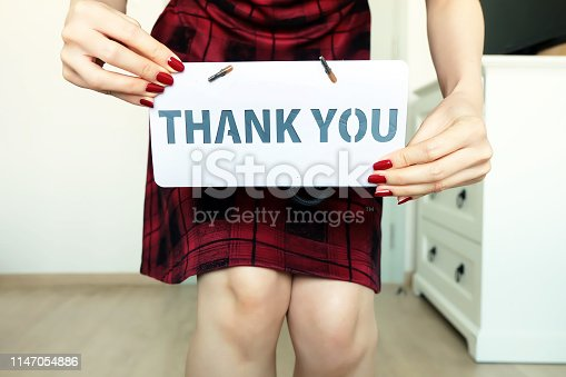 1094837778 istock photo Thank You Message. Female Hand Holding with The Words Thank You in the Room White Studio Background Great for Any Use. 1147054886
