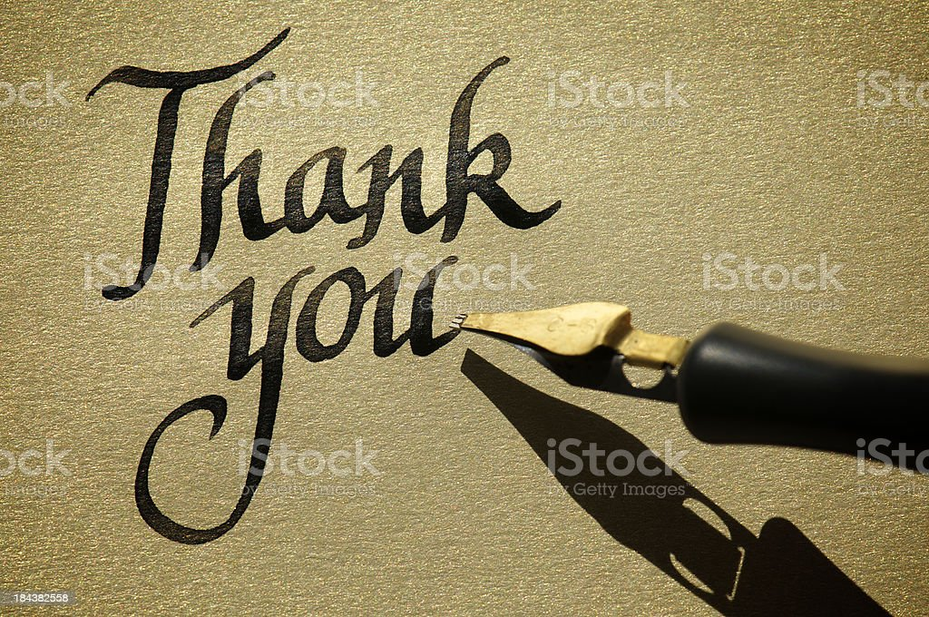 Thank You Message in Fresh Ink Calligraphy on Gold royalty-free stock photo