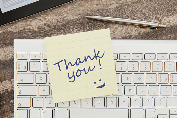Thank you message on adhesive note stock photo