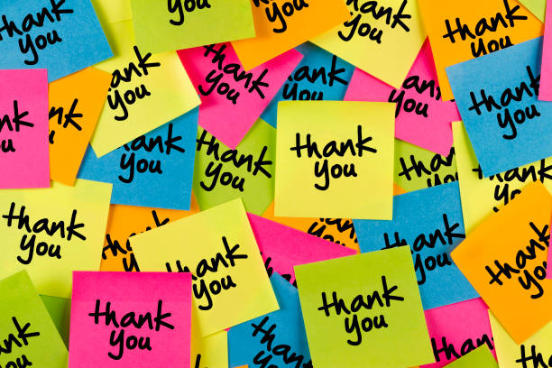 thank you message on adhesive notes on bulletin board - thank you стоковые фото и изображения