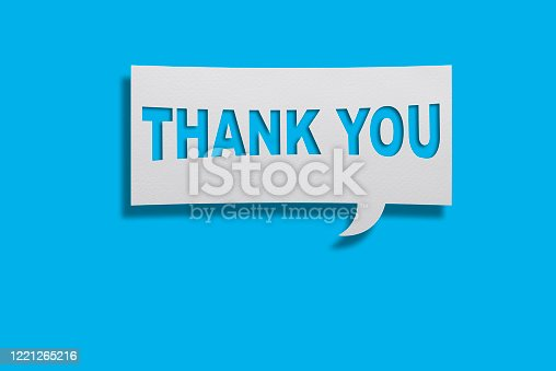 Thank You Message on White Speech Bubble on Blue Background With Copy Space.