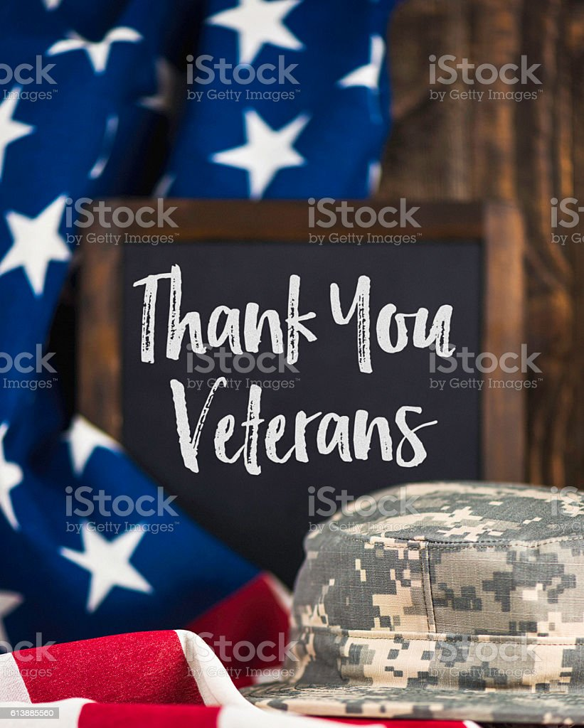 Thank you military veterans. US Army hat on American flag stock photo
