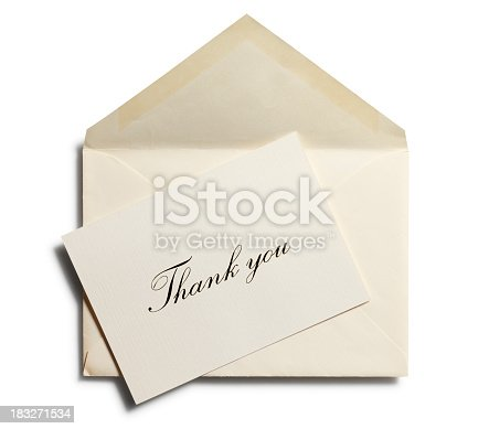 A thank you note at an angle on top of an envelope. Isolated on white with soft shadow.