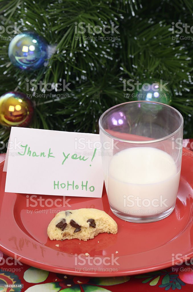 Thank you note from Santa Claus, leftover milk and cookie royalty-free stock photo