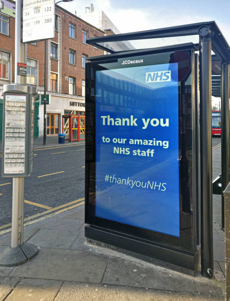 Thank you poster advertisement at local bus stop Lewisham, expressing gratitude to NHS staff dealing with coronavirus covid-19 outbreak in UK stock photo