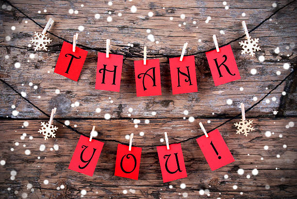 Thank You Tags on a Line in the Snow stock photo