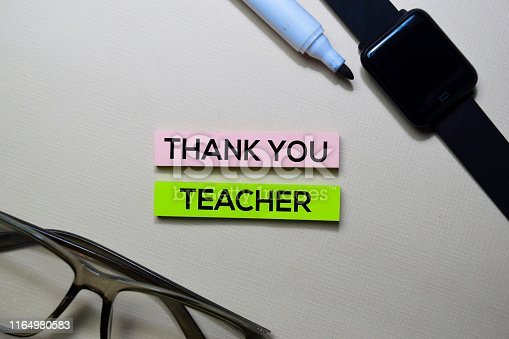 977488078 istock photo Thank You Teacher text on sticky notes isolated on office desk 1164980583