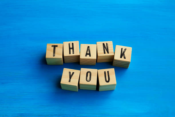 Thank you text / letters on blue background stock photo