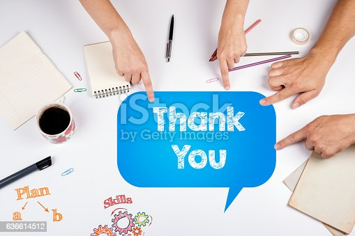 1050881964 istock photo Thank You. The meeting at the white office table. 636614512