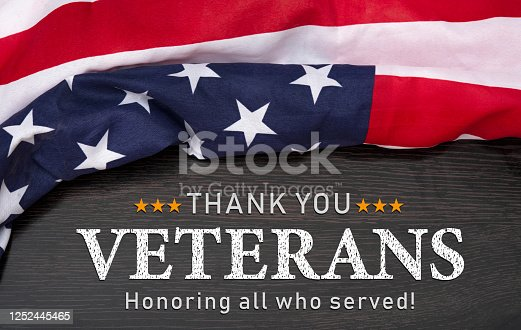 Thank you  Veteran design with USA flag on wood table.